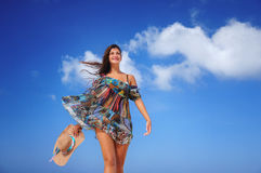 Young woman relaxing on exotic beach and enjoying the nice weath Stock Image