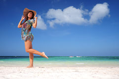 Young woman relaxing on exotic beach and enjoying the nice weath Stock Photography