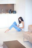 Young woman relaxing on the floor in a living room Royalty Free Stock Photo