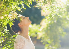 Young woman relaxing in forest Stock Image