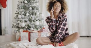 Young woman relaxing in front of a Christmas tree stock video