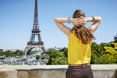 Young woman relaxing in front of Eiffel tower in Paris, France Stock Image