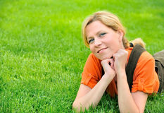 Young woman relaxing on the grass Stock Images