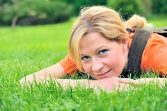 Young woman relaxing on the grass Royalty Free Stock Photography