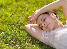 Young woman relaxing on grass. Young pretty  woman relaxing on grass Stock Photography