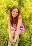 Young woman relaxing in the grass Stock Photos