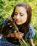 Young woman relaxing in the grass. Beautiful young woman relaxing in the grass Royalty Free Stock Photo