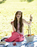 Young woman relaxing on the grass and eating Apples Stock Photos