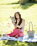 Young woman relaxing on the grass and eating Apples Royalty Free Stock Images