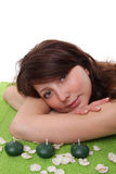 Young woman relaxing on a green towel Royalty Free Stock Photography
