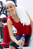Young woman relaxing in the gym after making exerc Stock Photography
