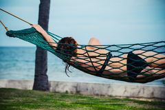 Young woman relaxing in hammock Royalty Free Stock Photography