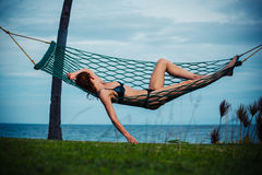 Young woman relaxing in hammock Royalty Free Stock Images
