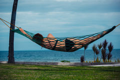 Young woman relaxing in hammock Stock Photos