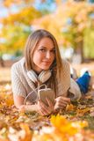 Young woman relaxing with her music in a park Royalty Free Stock Photography