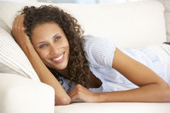 Young Woman Relaxing At Home Royalty Free Stock Photography