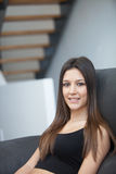 Young woman relaxing at home on her sofa Stock Photography