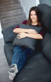 Young woman relaxing at home on her sofa Royalty Free Stock Photography