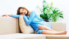 Young woman relaxing at home. Indoor portrait Stock Image