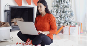 Young woman relaxing at home over Christmas Royalty Free Stock Photo