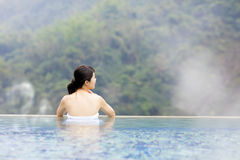 Young woman relaxing in  hot springs Royalty Free Stock Photos