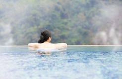 Young woman relaxing in  hot springs Royalty Free Stock Photo