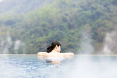 Young woman relaxing in  hot springs Stock Photography