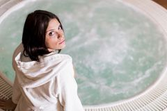 Young woman relaxing in the hot tub Stock Photos