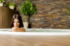 Young woman relaxing in the hot tub Stock Image