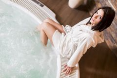 Young woman relaxing in the hot tub Royalty Free Stock Photo
