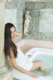 Young woman relaxing in hot tub Royalty Free Stock Photo