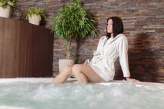 Young woman relaxing in hot tub Stock Image