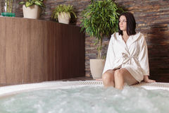 Young woman relaxing in hot tub Royalty Free Stock Image