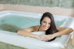 Young woman relaxing in hot tub Stock Images