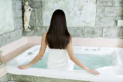 Young woman relaxing in hot tub Royalty Free Stock Photos