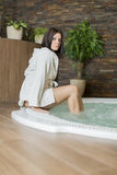 Young woman relaxing in hot tub Stock Photos