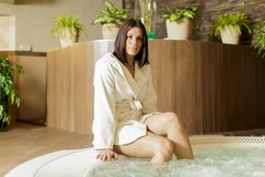Young woman relaxing by the hot tub Stock Images