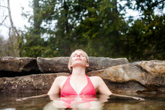 Young Woman Relaxing In A Nordic Spa Stock Images