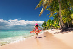 Young woman relaxing on the islands beach Royalty Free Stock Images