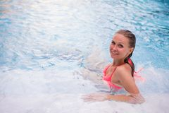 Young woman relaxing in jacuzzi spa in luxury hotel royalty free stock photography