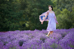 Young woman relaxing in lavender field Stock Images