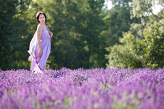 Young woman relaxing in lavender field Royalty Free Stock Photo