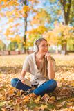 Young woman relaxing listening to music Royalty Free Stock Image