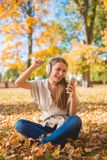 Young woman relaxing listening to music Royalty Free Stock Images