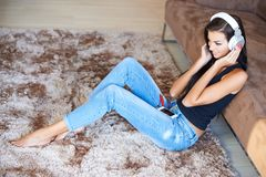Young woman relaxing listening to music Stock Photography