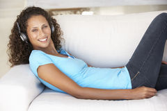 Young Woman Relaxing Listening To Music At Home Royalty Free Stock Photo