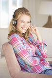 Young Woman Relaxing Listening To Music At Home Stock Images