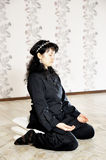 Young woman relaxing in lotus pose Royalty Free Stock Photography