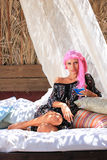 Young woman relaxing at lounge beach bar Stock Photography