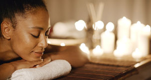 Young Woman Relaxing On A Massage Bench Royalty Free Stock Photo